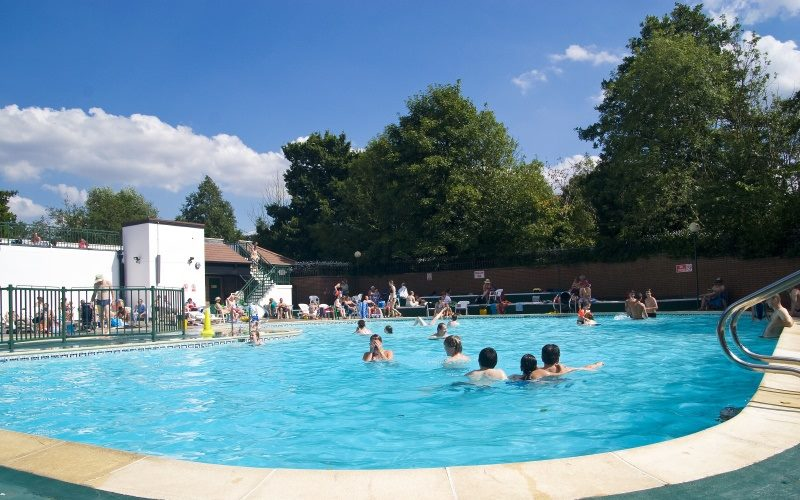 People swimming in an outdoor lido