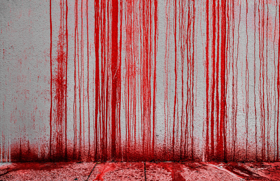 Blood streaming down a white wall