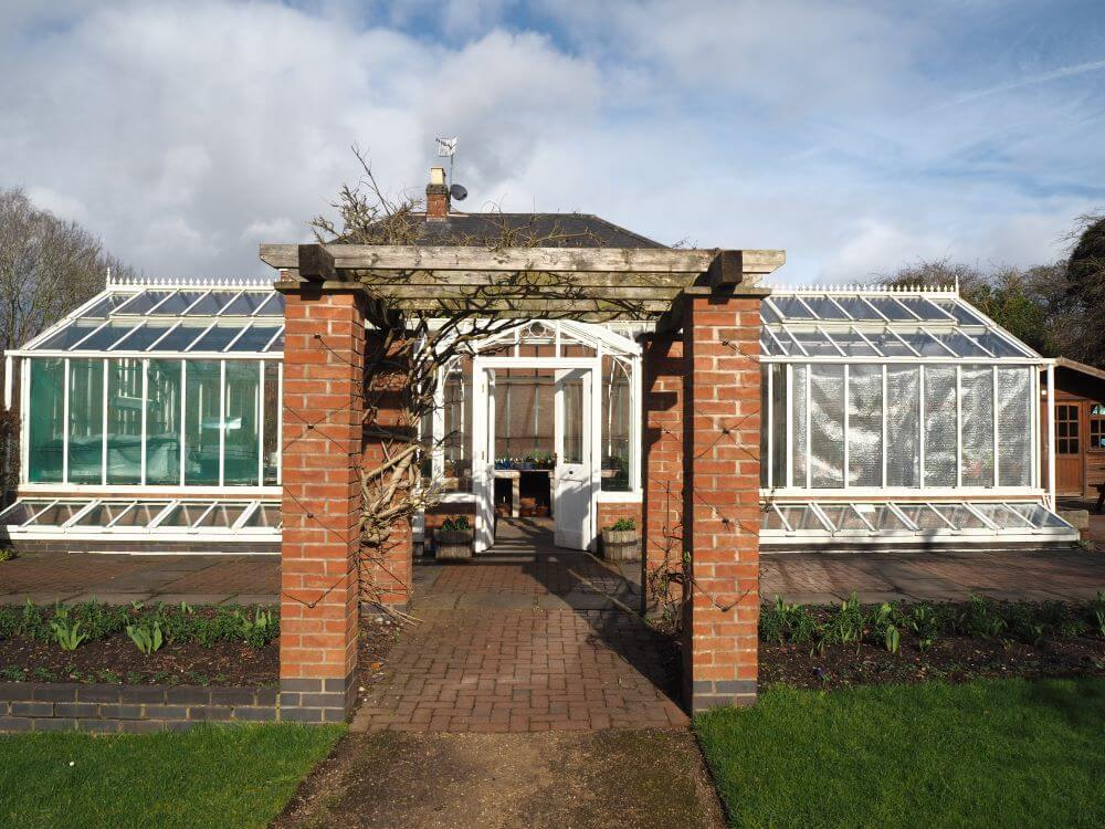 Traditional Victorian glasshouse at Hill Close Gardens