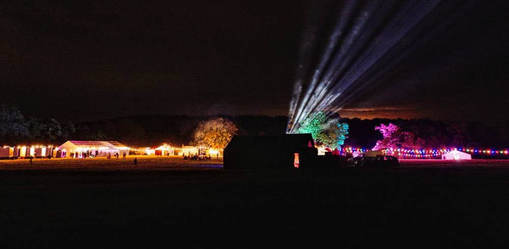 A festival site illuminated at night