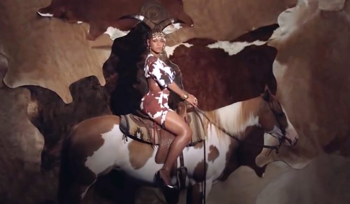 Beyonce sitting on a horse
