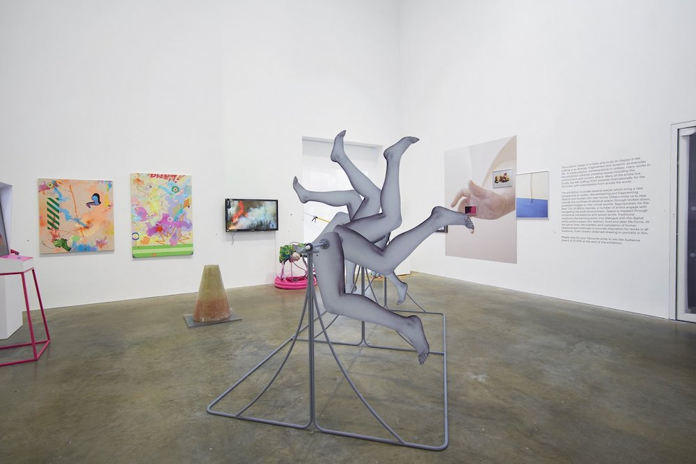 artworks including a sculpture with many legs in the air